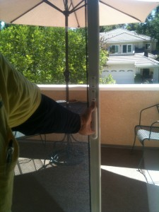 pulling a retractable screen door closed