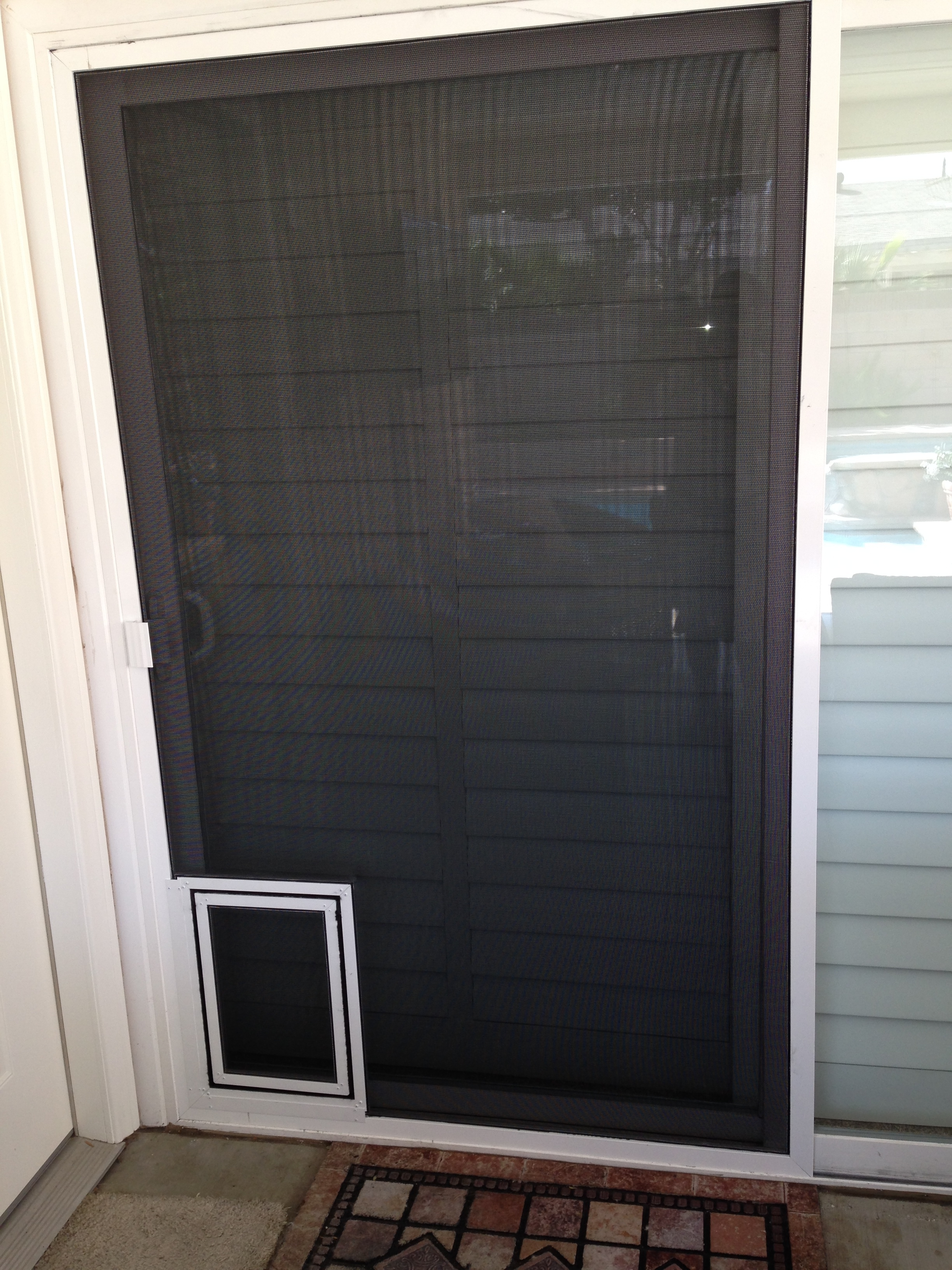 White Sliding Screen Doors With New Pet Door Installed In Simi