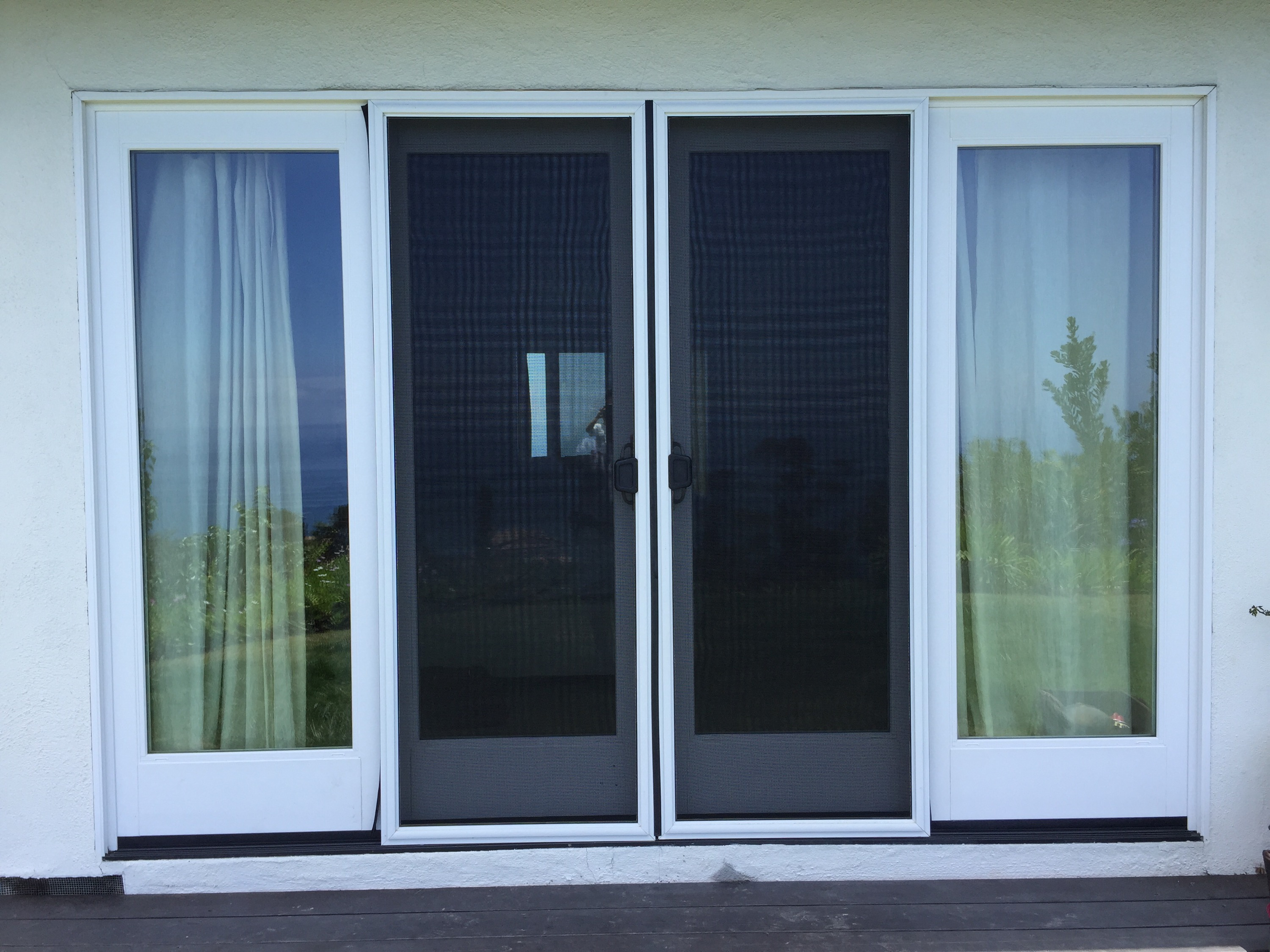 Double sliding screen door rescreening in malibu with pet for Double door screen door